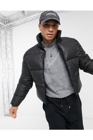 adidas Waxed cropped puffer jacket in