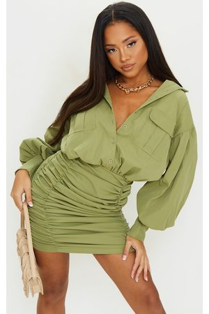 PRETTYLITTLETHING Olive Balloon Sleeve Pocket Detail Ruched Shirt Dress