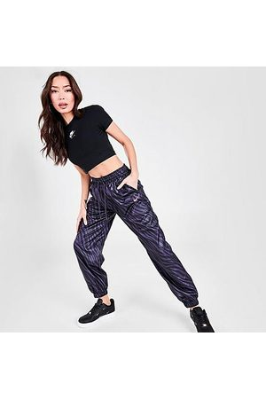 Nike Women's Sportswear Icon Clash Animal Print Woven Jogger Pants in /Dark Raisin Size X-Small 100% Polyester