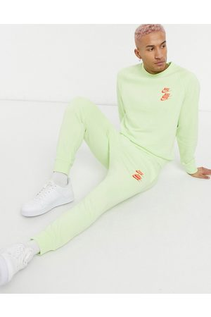 Nike World Tour Pack graphic cuffed sweatpants in lime