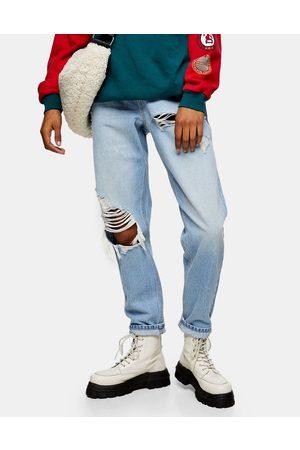 Topshop Mom tapered leg super rip jeans in bleach blue-Blues