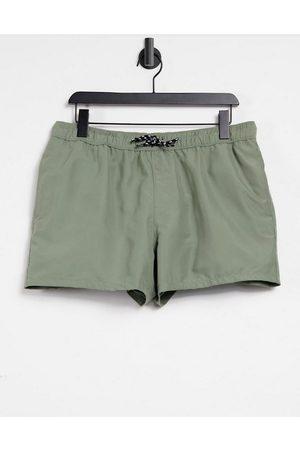 ASOS Swim shorts in khaki in short length