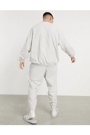 ASOS Oversized tracksuit with sweatshirt and sweatpants in reverse loopback light -Grey
