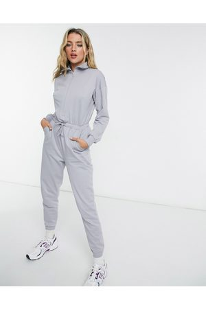 ASOS Zip front sweatpants jumpsuit in washed blue-Blues
