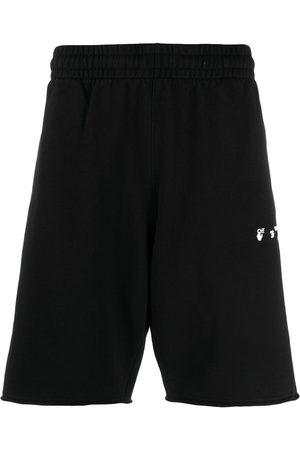 OFF-WHITE Logo-print knee-length track shorts