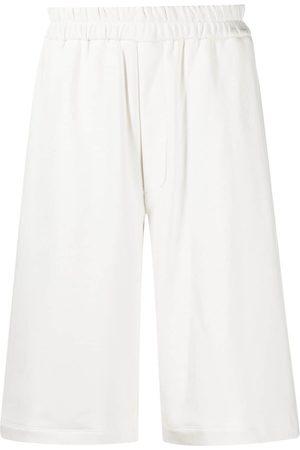 Jil Sander Embroidered logo track shorts