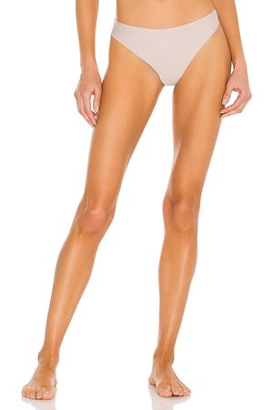 JIV ATHLETICS The Cameltoe Proof Mid Rise Thong in Neutral.