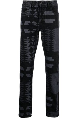 MARCELO BURLON Geometric-print jeans