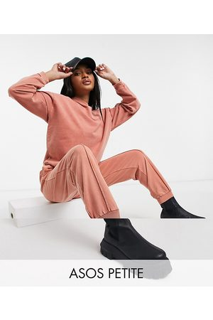 ASOS ASOS DESIGN Petite tracksuit oversized sweatshirt / oversized sweatpants with pintuck in acid wash in terracotta