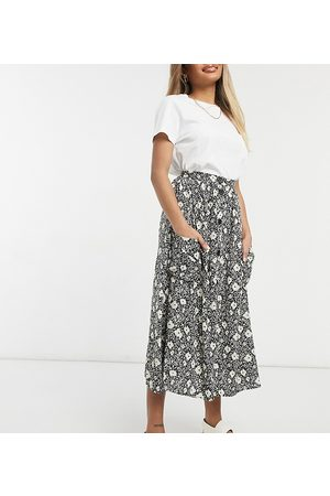 ASOS ASOS DESIGN Petite button through midi skirt with deep pocket detail in blurred floral print-Multi
