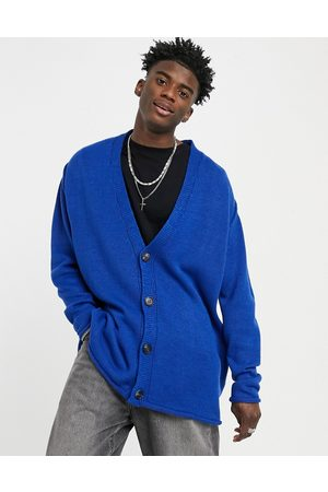 ASOS Knitted oversized textured button cardigan in cobalt blue-Blues
