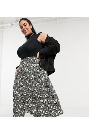 ASOS ASOS DESIGN Curve button through midi skirt with deep pocket detail in blurred floral print-Multi
