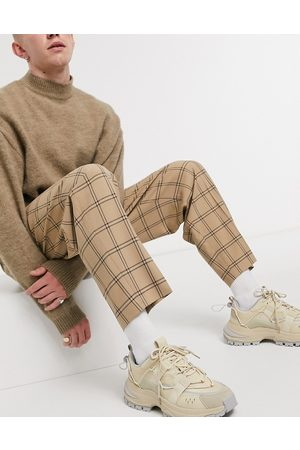 ASOS Oversized tapered smart pants in stone check