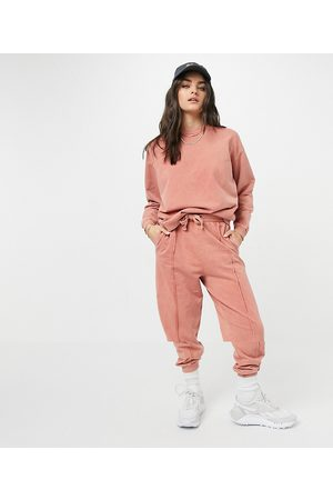 ASOS Tracksuit oversized sweatshirt / oversized sweatpants with pintuck in acid wash in terracotta