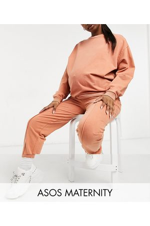 ASOS ASOS DESIGN Maternity tracksuit sweatshirt and pintuck front in acid wash in terracotta