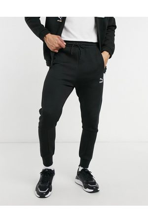 PUMA International track pants in and white