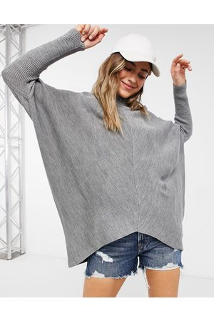 Style Cheat High neck knit sweater with asymmetric hem in -Grey