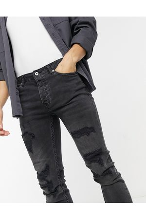 Topman Skinny jeans with rip and repair in washed