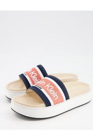 Calvin Klein Jaimee flatform sole logo slides in