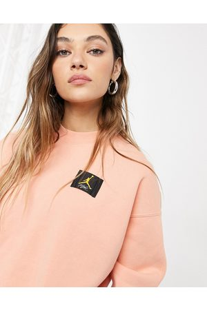 Jordan Women Hoodies - Nike crew neck sweatshirt in peach