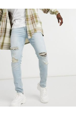 ASOS Skinny jeans in vintage light wash with rips-Blues