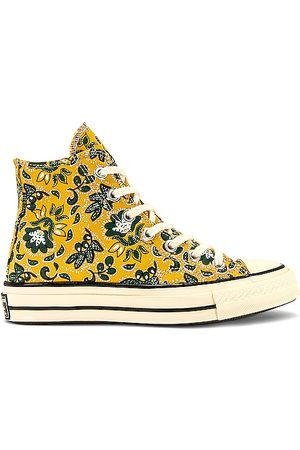 Converse Chuck 70 Hi Sneaker in Yellow.