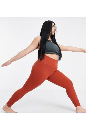 Nike Women Leggings - Nike Yoga Plus Infinalon 7/8 leggings in rust