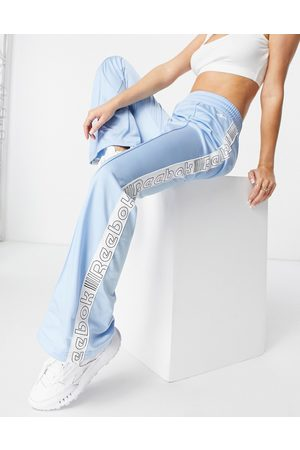 Reebok Meet you there track pants in blue-Blues
