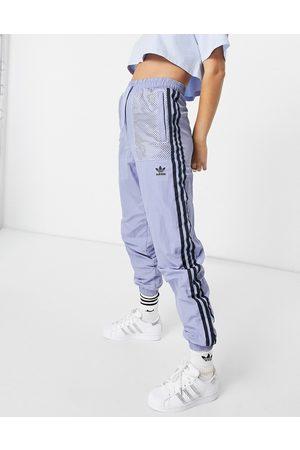 adidas Nylon pants in blue-Blues