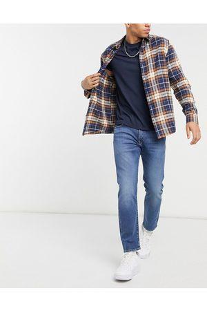Levi's Men Stretch - 502 taper jeans in corfu too static flex stretch mid indigo worn in wash-Blues