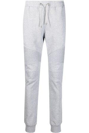 Balmain Men Sweatpants - Flock ribbed logo track pants - Grey