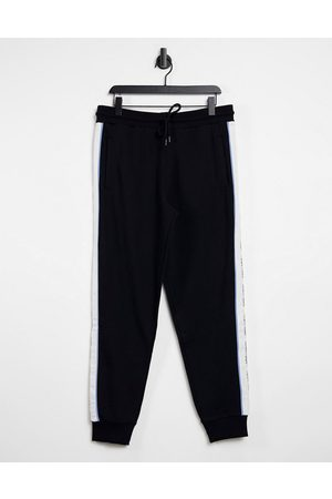 ASOS Tapered sweatpants in with logo taping - part of a set