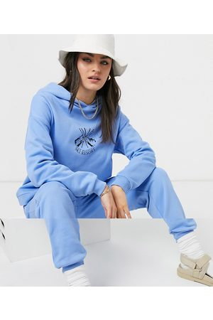 ASOS Tracksuit oversized hoodie / oversized sweatpants with ski motif in blue