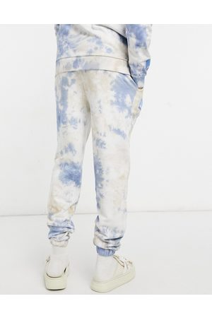 ASOS ASOS Daysocial matching sweatpants in and blue tie-dye with logo print