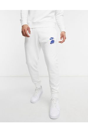 Nike World Tour Pack graphic cuffed sweatpants in