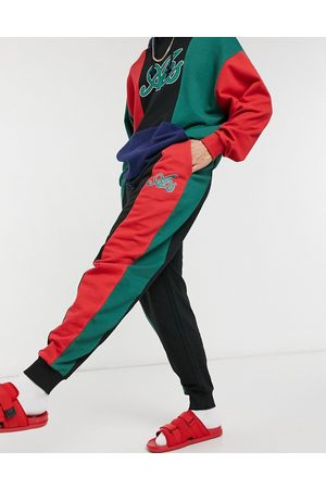 ASOS Oversized sweatpants set in with green and red colorblock cut and sew