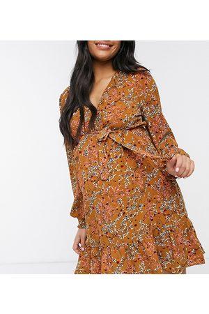 Mama Licious Mamalicious Maternity mini wrap dress with frill hem in rust floral-Multi
