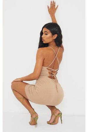 PRETTYLITTLETHING Nude Strappy Pointy Hem Lace Up Back Bodycon Dress
