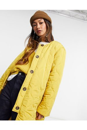 Ghospell Quilted oversized coat in mustard