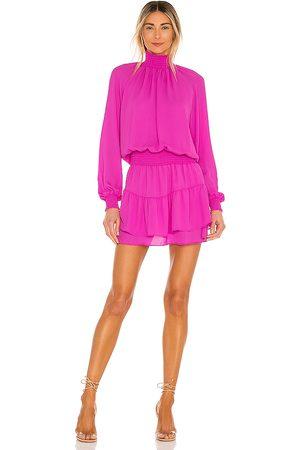 krisa Turtleneck Ruffle Skirt Dress in Purple.