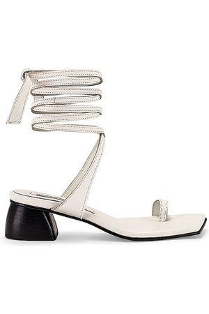 Reike Nen Toe Ring Sandals in Ivory.