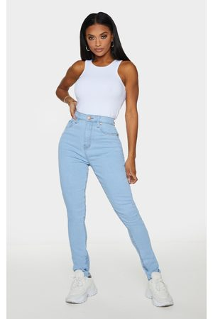 PRETTYLITTLETHING Shape Light Wash High Waist Super Stretch Skinny Jeans