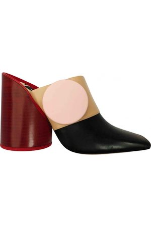 Jacquemus Bouton Leather Mules & Clogs for Women
