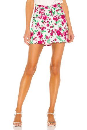 For Love & Lemons Janelle Mini Skirt in Pink.