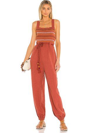 Free People Women Jumpsuits - Sienna Smocked Jumpsuit in Brick.