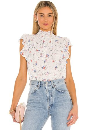 1. STATE Tranquil Ditsy Garden Sleeveless Blouse in .