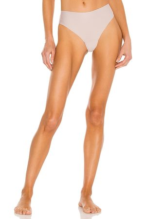JIV ATHLETICS The Cameltoe Proof High Rise Thong in Neutral.