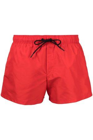 VERSACE Logo-print swim shorts
