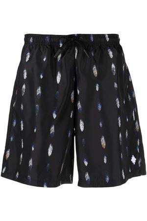 MARCELO BURLON Feather-print swim shorts