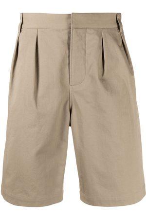 Saint Laurent Men Shorts - Pleat-detail knee length shorts - Neutrals